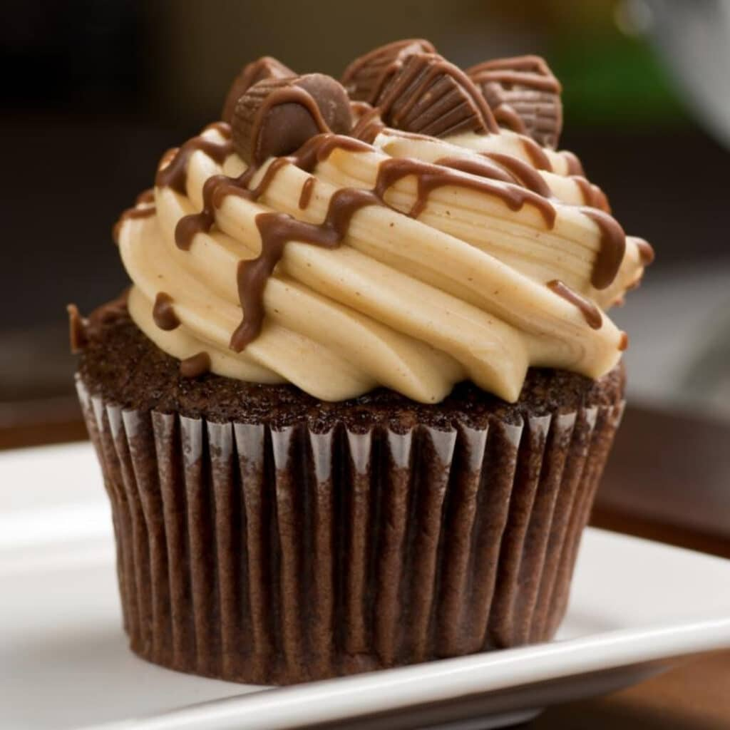 An image of a cupcake topped with Emerald Sky peanut butter cup edibles.